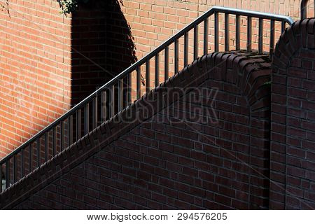Side View Of The Brick Staircase In A Shadow. Hamburg, Germany