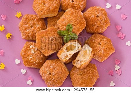 Teatime of puff pastries with custard cream. poster