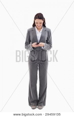 Businesswoman writing a text message against white background