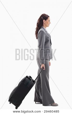 Profile of a businesswoman with a suitcase against white background