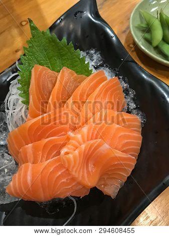 Salmon Sashimi Slice On Dish Ready For Eat