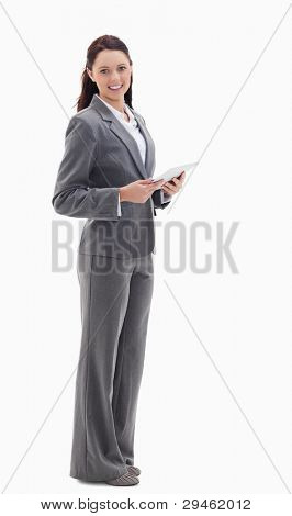 Profile of a businesswoman smiling with a touch pad against white background