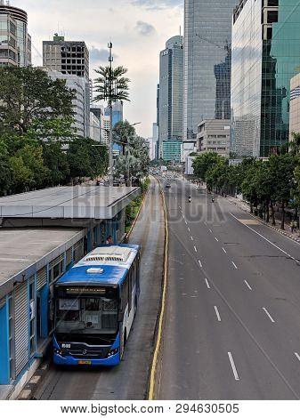 Jakarta, Indonesia - February 16, 2019: Transjakarta Bus Passing Through Jalan Thamrin (thamrin Stre