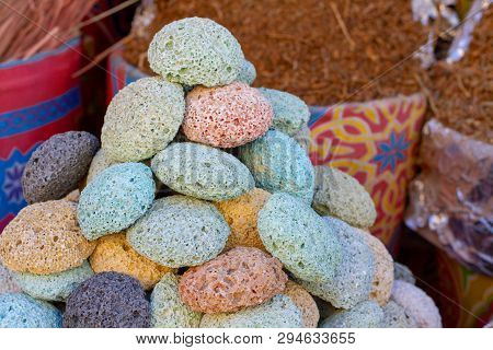 Multicolored Volcanic Pumice In The Eastern Bazaar. Pumice Sale For Body Care In The Market. Pumice