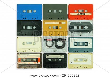 Collection Of Colorful Old Audio Cassette Tape Isolated On A White Background