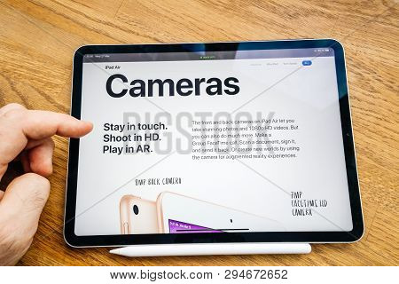 Paris, France Mar 27, 2019: Man Hand Pov Looking At The New Ipad Pro Featuring Apple Computers Websi