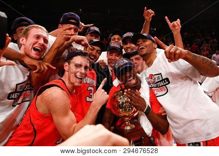 NEW YORK-MAR 10: Louisville Cardinals head coach Rick Pitino & players celebrate after beating the Cincinnati Bearcats of the Big East Tournament on March 10, 2012 at Madison Square Garden in New York