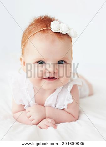 Portrait Of Beautiful Smilling Infant Baby Girl, Four Months Old