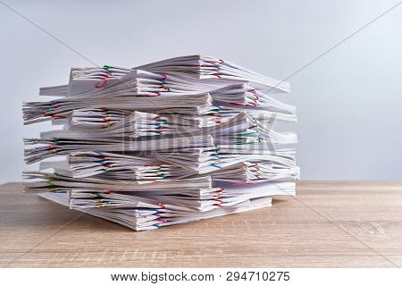 Pile Overload Paperwork Report On Wood Table With Copy Space