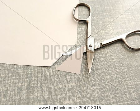 Cutting Corners Idiom Briticism Hand Takes Sheet Of Paper And Cutting Corners By Scissors Doing Some