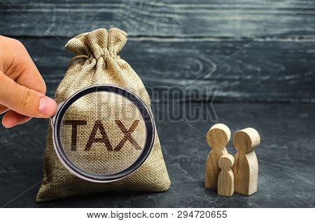 A Bag With The Word Tax And Family. Taxes On Real Estate, Payment. Penalty, Arrears. Register Of Tax