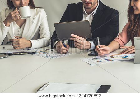 Businessman And Businesswomen Working In Office.