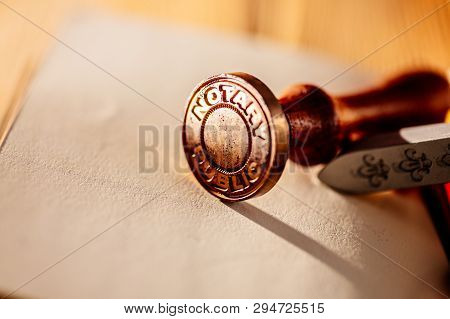 Old Notary Public Metal Stamp On Paper