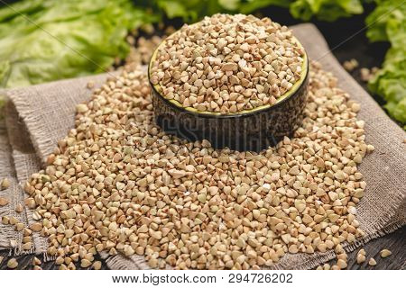 Seeds Green Buckwheat On A Dark Background. Vegan Nutritious And Healthy Product. Concept Of Organic