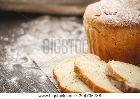 Homemade Natural Fresh Bread With A Golden Crust On A Napkin On An Old Wooden Background . Baking Ba