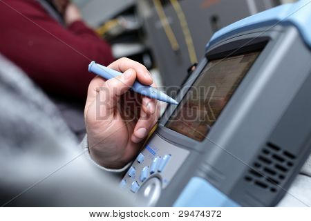Technician With Telecom Analyzer
