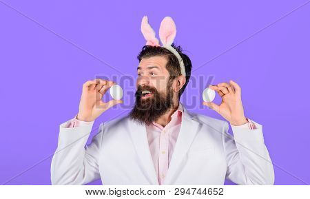 Easter Day. Spring Holiday. Bearded Man With Bunny Ears Holds White Eggs. Egg Hunt. Easter Bunny. Ea