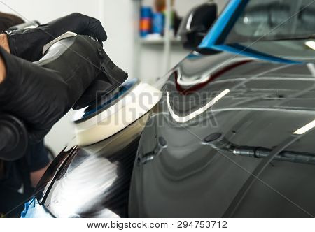 Car Polish Wax Worker Hands Applying Protective Tape Before Polishing. Buffing And Polishing Car. Ca