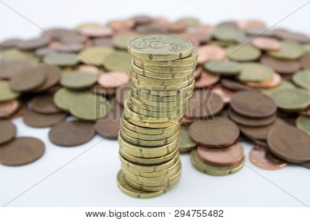 Stack Twenty Euro Cent Coins On More Coins Of Little Value. Savings Of Coins