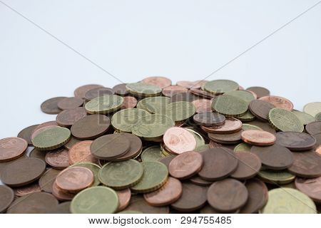 Many Euro Cents Coins On White Background. Savings Of Coins.