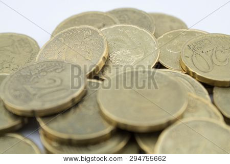 Several Twenty Euro Cent Coins On White Background. Coins With Little Value.