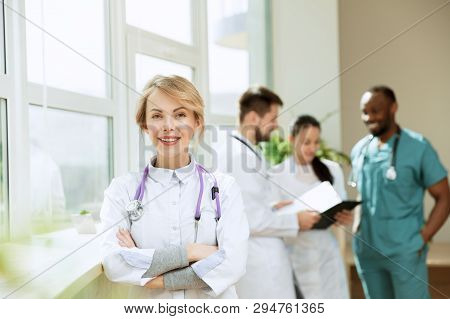 Healthcare People Group. Professional Female Doctor Posing At Hospital Office Or Clinic. Medical Tec