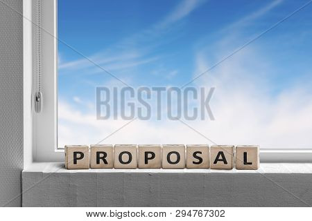 Proposal Sign In A Window With A View To A Heavenly Blye Sky In Bright Light