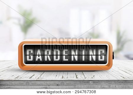 Gardening Alarm Message In A Bright Room In The Spring With Houseplants In The Background