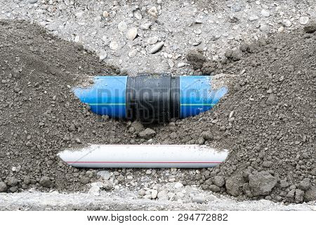 Laying Large Industrial Water Pipes In An Earth And Dirt Ditch For Water Supply And Irrigation