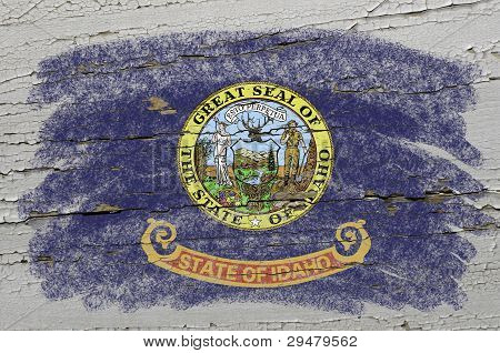 Flag Of Us State Of Idaho On Grunge Wooden Texture Precise Painted With Chalk
