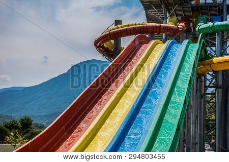Riding Water Slides In The Water Park