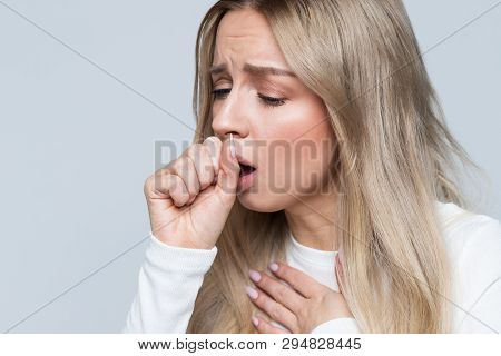 Closeup Portrait Of Unhealthy Young European Blonde Woman Coughing A Lot, Suffering With Cough, Has