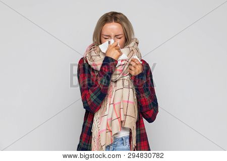 Young Blonde Caucasian Upset And Sick Woman Sneezing Or Using Handkerchieif To Wipe Snot From Her No