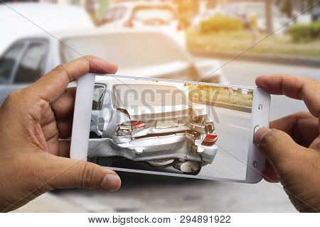 Car Insurance Agents Take Pictures Of Accident-damaged Vehicles With A Smartphone As A Proof Of Insu