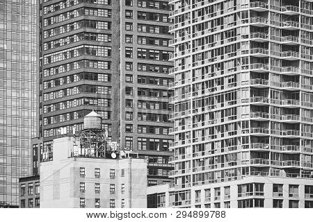 Water Tower On A Building Rooftop, New York.