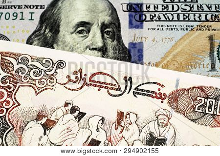 A Close Up Image Of An American One Hundred Dollar Bill With An Algerian Two Hundred Dinar Bank Note