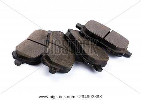 Set Of Old Brake Pads, Car Spares Isolated On White Background