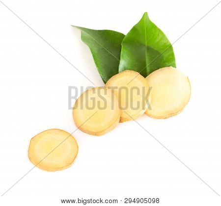 Fresh Ginger Root Sliced On White Background For Herb And Medical Product Concept