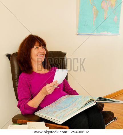 Mature woman planning her next trip