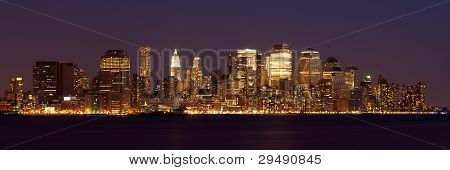 New York - Panoramic view of Manhattan Skyline by night poster