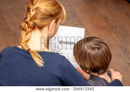 Mother Comforting Son Despite The Bad School Certificate - Translation: Certificate Day Of Birth Dis