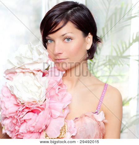 beautiful flowers woman with spring pink dress portrait