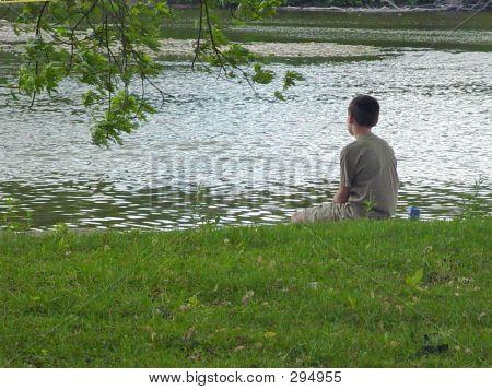 Boy By River