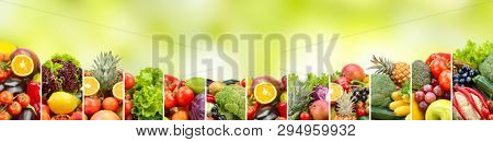 Panorama fruits and vegetables on natural blurred green background. Copy space