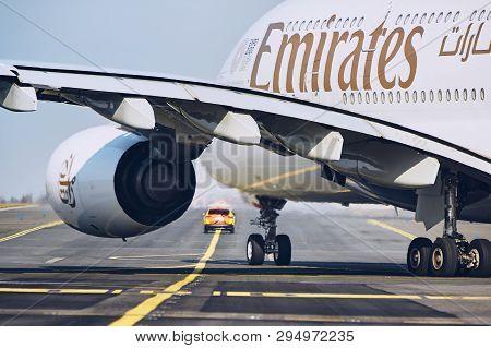 Prague, Czech Republic - March 29, 2019: Emirates Airbus A380 Follow Aircraft Marshaller Car To Runw