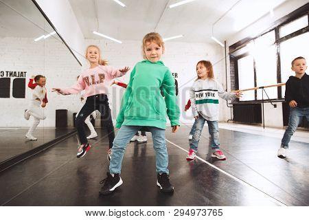 The Kids At Dance School. Ballet, Hiphop, Street, Funky And Modern Dancers Over Studio Background. C