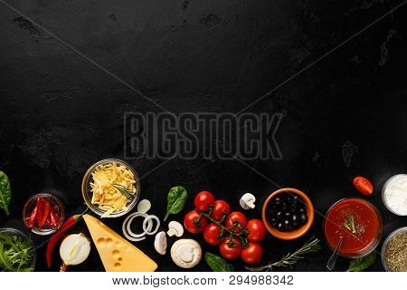 Frame Of Pizza Cooking Ingredients, Vegetables And Cheese On Black Background With Copy Space