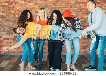 Friends Hangout. Fun Together. Team Spirit. Group Of Cheerful Millennials Laughing, Enjoying And Ent