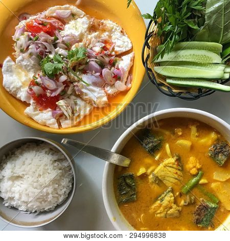 Rice With Fired Egg And Orange Curry And Vegetable
