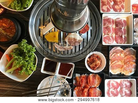 Pork And Beef Barbecue Grill Buffet With Fresh Vegetable